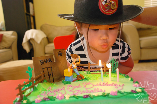 My little cowgirl blowing out her birthday candles