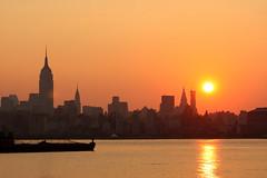 Sunrise over Manhattan ( estatik ) Tags: nyc orange sun lighthouse ny newyork reflection sunrise river pier newjersey haze jerseycity waterfront drawing manhattan nj newport empirestatebuilding hudson pavonia wildcard clicks