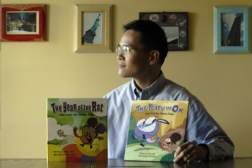 Oliver Chin and his new Chinese Zodiac books (Photo by Karl Mondon/CC Times)