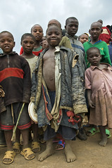 RWANDA - Barefoot Children/ Very Poor Kids - Twa, Pygmy (Marie-Marthe Gagnon) Tags: africa portrait people feet smile kids portraits foot holocaust shoes expression rags poor tribal rwanda barefoot groundlevel congo uganda 5000 tribe cloths twa drc famine needy pygmy bantu 2f pleasehelp poorkids manshoes flickrchallengegroup flickrchallengewinner geoafrica mariegagnon mariemarthegagnon pygmiesphoto photosofpygmies