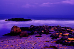 Into the Horizon (Moniza*) Tags: ocean longexposure sunset sea sky seascape beach nature water clouds sunrise landscape newjersey twilight sand nikon rocks waves nj rocky explore shore jersey bluehour jerseyshore longbranch d90 explored explorefrontpage moniza