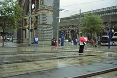 everything is ok... (don_philippe) Tags: storm film wet rain station analog umbrella 35mm schweiz switzerland bessa luzern bahnhof vista 135 r3a agfa ok lucerne regen voigtlnder nass sturm schirm