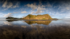 Stepping Back (Nick Twyford) Tags: newzealand panorama seascape clouds reflections blacksand nikon auckland nz northisland westcoast karekare wetsand lateafternoonlight wetfeet coastallandscape colourimage leefilters d7000 lee09nd nikon1024mmafsnikkorf3545gdxed lee06gndsoft phottixgeoone mirrorsand vision:sunset=0604 vision:mountain=0862 mpr192nodalslide vision:sky=0947 vision:clouds=0938 tvc33bh55