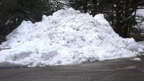 Snow on parking lot, Migros, Langendorf