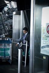 cigarette smoking man (Navelless) Tags: man airport asia petronas smoking malaysia southeast klia navelless
