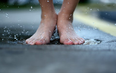 Down! (~Kerry Murphy) Tags: boy feet water puddle kid child play son laugh splash aftertherain outwalking boychild