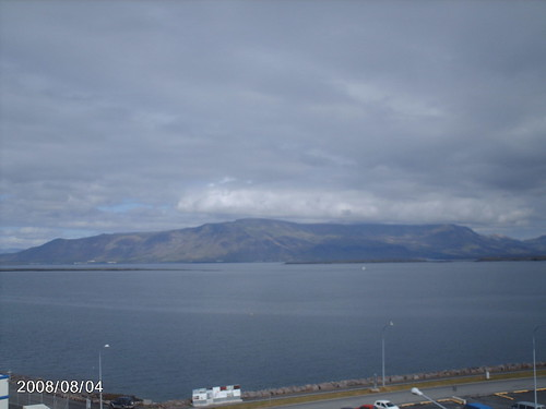 Vy från mitt hotellrum här på Island. Mt. Esja syns vaka överstaden på andra sidan bukten