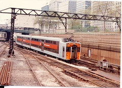 Illinois Central electric Bi leval commuter train entering Randolph Street station. Chicago Illinois. May 1983.