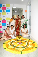 Yahoo! Onam (RMZ Office) (Laughingbudai) Tags: india yahoo jay bangalore kerala canon350d girlsandboys pookkalam flowerdecoration rmzecospace onam2008 poovidal gettingreadytowelcomemahabali