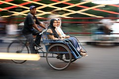 ladies on a becak (Farl) Tags: travel bridge colors java muslim islam hijab culture tradition panning jawa surabaya becak jembatan eastjava jawatimur jembatanmerah