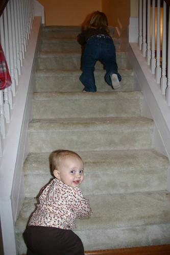 Maddie chasing Anna upstairs