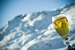 Great refreshments (ole) Tags: sky sun mountain snow france beer glass yellow montagne alpes gold europe dof bokeh bubbles bubble savoie meribel mribel mounts 3valles rhonealpes mnuires noticings