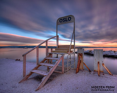 Gateway to Oslo (mortenprom) Tags: ocean blue light sunset sea sky sun snow color beach nature sign yellow oslo norway stone clouds stairs landscape concrete golden norge wooden gate rocks day cloudy tripod skandinavien january norwegen wideangle shore gateway noruega portal scandinavia peninsula 2009 hdr oslofjord bygdy habour huk noorwegen noreg wideangel sigma1020mm ndfilter nesodden skandinavia nd1000 nd30 dynafyr aplusphoto nesoddtangen canoneos40d 10stopnd mortenprom