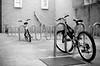 receding bikes (xgray) Tags: bw 3 film bike bicycle analog cn canon austin eos 50mm prime three texas jester kodak 400 kodakbw400cn bikerack bw400cn c41 ef50mmf14usm kodakprofessionalbw400cn 1n canoneos1n jestercenter postedtophotographersonlj postedtobwphotographyonlj