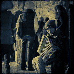 The accordion player (manganite) Tags: street blue boy people urban musician berlin texture yellow kids contrast digital vintage germany children square geotagged kid high nikon europe artist child tl framed candid unterdenlinden young streetscene overlay accordion instrument d200 busker nikkor dslr toned mitte textured museumsinsel 18200mmf3556 utatafeature manganite nikonstunninggallery date:month=december repost1 date:year=2008 date:day=31 geo:lat=52517772 geo:lon=1339886 format:orientation=square format:ratio=11 repost2 repost3
