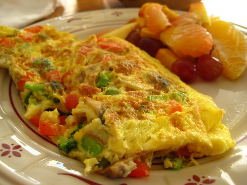 veggie omelet with fruit salad