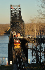 Kansas City Southern 4100 Eastbound Over the Mississippi River (Jim Frazier) Tags: railroad morning light red yellow metal sunrise river mississippi landscape dawn scenery commerce technology diesel v100 steel january scenic structures bridges beautifullight engineering railway trains fv5 headlights f10 equipment machinery commercial engines transportation ms infrastructure g1 f3 machines shipping f5 2009 freight vicksburg locomotives crossings spans kcs cantilever truss v200 civilengineering interestinglight v500 v1000 q4 v2000 kansascitysouthernrailway kansascitysouthern dieselelectric explored mississippibridge throughtruss kcsr railwayinfrastructure 20090125almsswing 20090130vicksburgbridges 20090130vicksburg 090131c kansascitysouthernrailwaycompany ld2009 ldfebruary bookmarkprint jimfraziercom wmembed