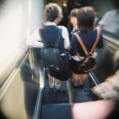 Schoolgirls on an escalator (Eric Reichbaum) Tags: girls asian holga lomo lomography escalator korea seoul backpack schoolgirls napsack    earthasia