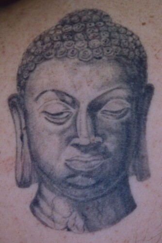 buddha tattoo. uddha head tattoo
