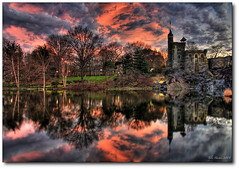 Mystery Over Belvedere (Tyler Huston) Tags: sunset sky newyork reflection clouds centralpark manhattan highdynamicrange turtlepond belvederecastle photomatix anawesomeshot