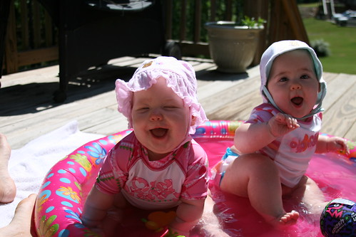 playing in the pool with big smiles!