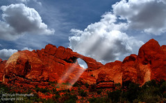 Skyline Arch and Sun Rays (Bill Wight CA) Tags: nature landscape utah contest arches redrocks sunray 35faves platinumphoto goldenphotographer proudshopper goldstaraward damniwishidtakenthat billwight graphicmaster