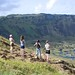 Rebecca Inman, Margret Barnes and Mikaela Clark stand with Annette Rapu atop Rano Kau volcano, looki