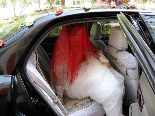 Bride getting down the car