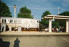 A bright and sunny summer morning at the CTA Dempster Street station. Skokie Illlinois. July 2008<br />.