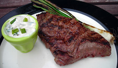 steak with grilled green onion sauce