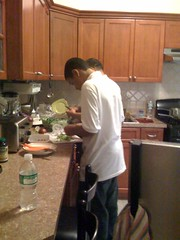 My brother and my father cooking dinner for the family