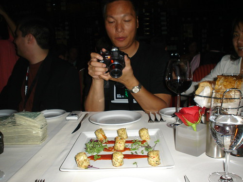 John Chow taking a picture of the food