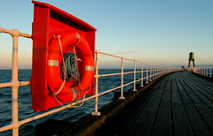 Whitby pier (redeyesatdawn) Tags: sea sky orange dawn pier seaside fishing nikon gothic d70s rope whitby rails starboard lifebouy seafishing flickrsbest aplusphoto