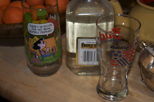 Would the decades old bottle of Triple Sec taste better in a World Cup glass or a Camp Snoopy glass?