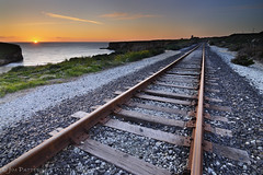 Northbound (Jim Patterson Photography) Tags: ocean california railroad sunset sky santacruz sun beach train coast vanishingpoint pacific shoreline tracks coastal shore rails coastline davenport bonnydoon northbound nikond300 tokina1116mm beneathblueseas beneathblueseascom jimpattersonphotography goldendiamondblog jimpattersonphotographycom seatosummitworkshops seatosummitworkshopscom