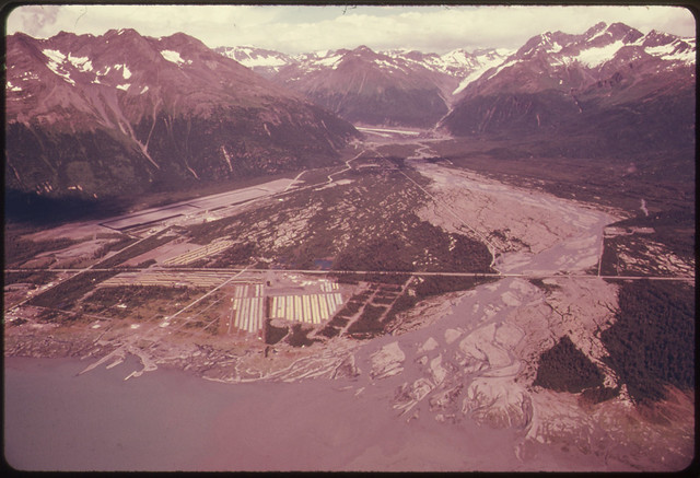 View Northeast Across Valdez River Floodplain Showing Pipe Storage Yard Center Foreground Which Holds 418 Miles of Pipe Yards at Fairbanks and Prudhoe Bay Hold 238 and 168 Miles of Pipe Respectively081974 by The US National Archives