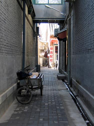 Narrow shaded cobblestone alleyway