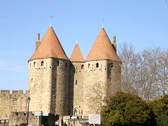 Welcome to Carcassonne (Annie in Beziers) Tags: city blue sky france fairytale towers entrance medieval restored welcome bienvenue labyrinth carcassonne languedoc cathars crusades smrgsbord fortified occitan lesud katemosse annieinbziers