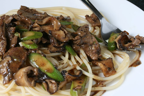 Garlic Beef with Asparagus and Shiitakes over Noodles