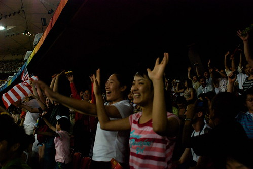 Yes, they do the WAVE in China. It went around the Birds Nest five times until the Jumbotron told us Quiet Please!