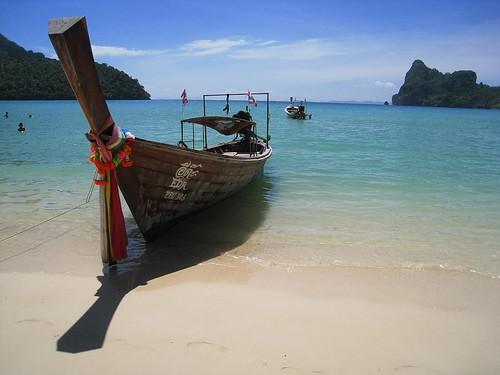 A longboat sits idle