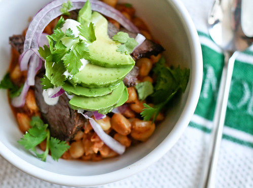 spicy pozole with steak, avocado & lime