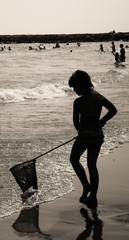 lady mermaid (adudi) Tags: venice sea italy sun net beach lady walking fishing waves child shot shot2 mermaid venezia siren sirena bambina veneto eraclea blackwhiteaward sarching adudi