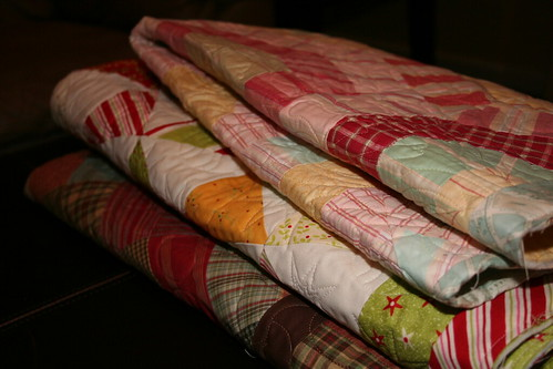 Stack of quilts by you.