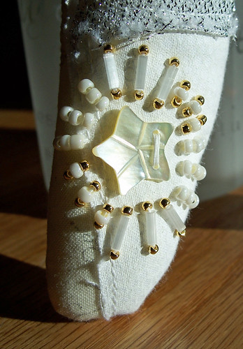Star doll beading (on leg)