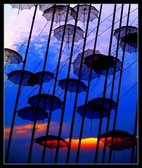 umbrellas of zogolopoulos in Thessaloniki Greece (maios) Tags: camera travel blue sunset red sky sculpture cloud sun color art water metal digital port umbrella greek boat photo europa europe flickr mediterranean ship photographer hellas olympus greece macedonia thessaloniki fotografia soe salonica manikis maios iosif   heliography     mywinners abigfave zogolopoulos    platinumphoto   overtheexcellence goldstaraward       oltusfotos    iosifmanikis