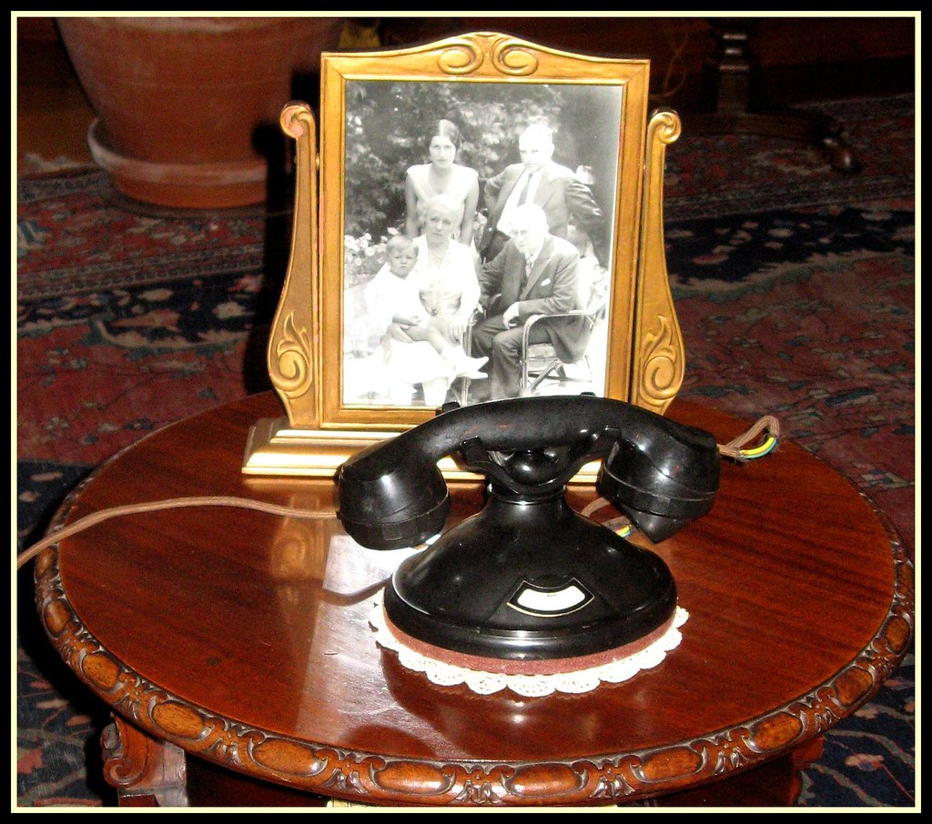 Old Fashioned Telephone and Family Photo