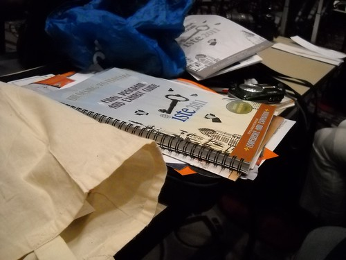 A stack of conference bag loot to be thrown away