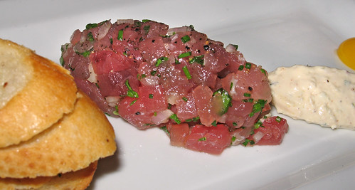 Yellowfin Tuna Tartare with Shallots, Quail Egg, Herbed Creole Cream Cheese and Garlic Crostini