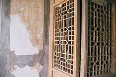 Temple at the Twin Pagodas of Baisikou (spinningstill) Tags: china door wall lattice